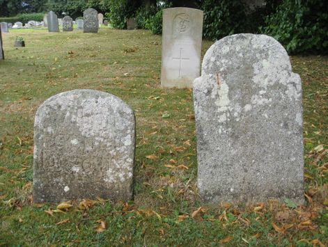 Two 18th century headstones near the path to the church, described as