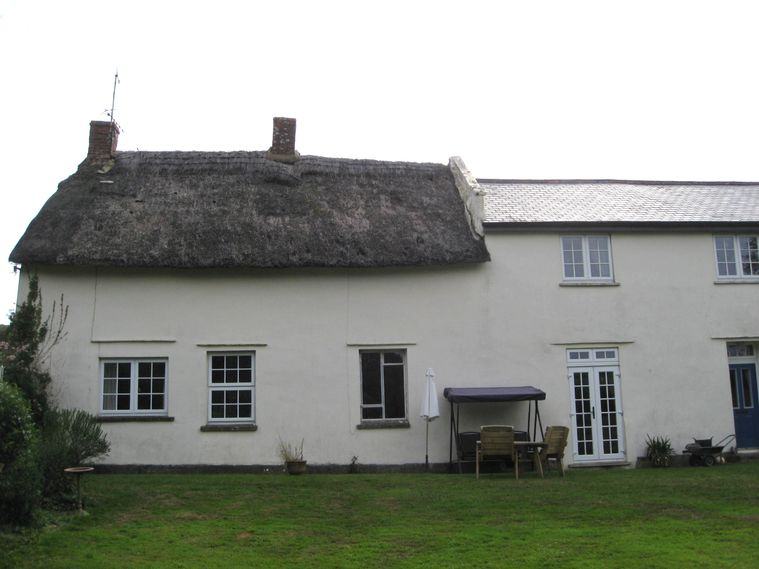 The original farmhouse together with part of the later extension. The middle window would once have been a door to the cross passage.